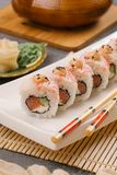 On the plate is white, lined with delicious rolls, sushi, Red, black, Philadelphia sesame royalty free stock images
