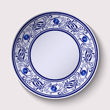 Plate with a wide floral design border in the style of Gzhel with an empty space in the center. Stock Image