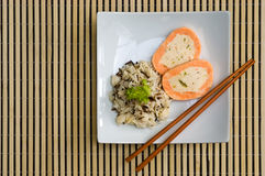 Plate of wild rice and salmon roulade. Delicious chinese food: wild rice and stuffed salmon Stock Photos