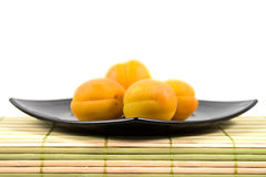 Plate With Apricots Stock Photos