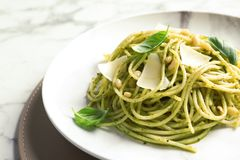 Free Plate With Delicious Basil Pesto Pasta On Table Stock Image - 132793491