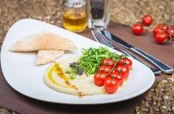 Plate With Hummus Dip And Tapas Royalty Free Stock Photos