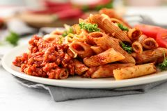 Free Plate With Tasty Penne Pasta And Bolognese Sauce On Table, Closeup Royalty Free Stock Photo - 150018505
