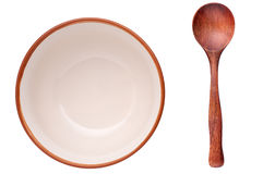 Plate and wooden spoon. One empty plate and wooden spoon isolated on white background Stock Photography