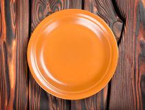 Plate on a wooden table Stock Images