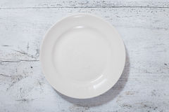 Plate on wooden table Royalty Free Stock Photo