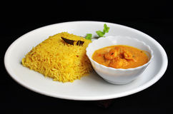 Plate of  Yellow pulao and Prawn malai curry with coconut milk Royalty Free Stock Images