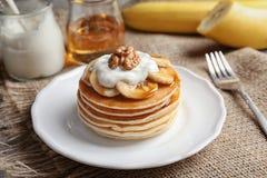 Plate with yummy banana pancakes Stock Photos