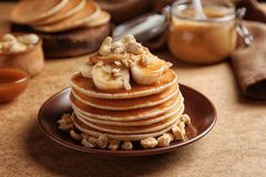Plate with yummy banana pancakes royalty free stock image