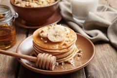 Plate with yummy banana pancakes Royalty Free Stock Photo