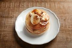 Plate with yummy banana pancakes Royalty Free Stock Photos