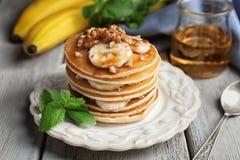 Plate with yummy banana pancakes Stock Photo