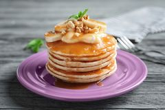 Plate with yummy banana pancakes Stock Images
