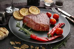 Plate with yummy steak. Closeup stock photography
