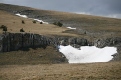 Plateau of the Crimean mountains. With snow spots Royalty Free Stock Photos