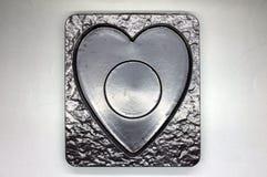 Plateau en plastique vide dans la forme de coeur photos libres de droits