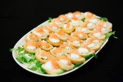 Plateau with salmon mini sandwiches Royalty Free Stock Photo