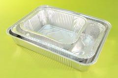 Plateaux en aluminium de restauration Photos stock