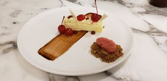 Plated Cherry cheesecake stock photography