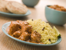 Plated Chicken Korma with Pilau Rice. And Naan bread Royalty Free Stock Images