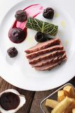 Plated duck breast meal Stock Photos