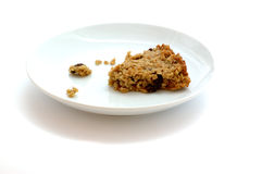 Plated Flapjacks. Flapjack oat bar on a plate isolated on white Royalty Free Stock Photo