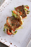 Plated seabass fish meal Royalty Free Stock Image