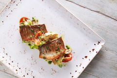 Plated seabass fish meal Stock Image