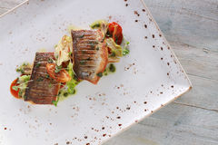 Plated seabass fish meal Royalty Free Stock Photo