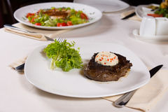 Plated Steak with Herbed Butter at Place Setting Stock Photos