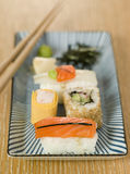 Plated Sushi with Wasabi Sushi Ginger and nori Royalty Free Stock Image