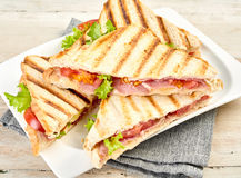 Plated of toasted or grilled ham sandwiches royalty free stock photos