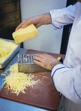 Scratching cheese. Plated work of chef in restaurant kitchen scratching cheese stock images