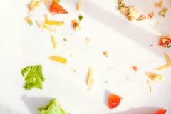 Platee con la comida de las migas y la bifurcación usada Fotos de archivo