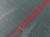 Platee la superficie de metal con la línea roja marcada, Imágenes de archivo libres de regalías