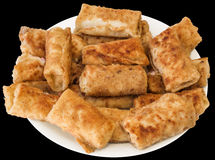 Plateful of Breaded Cheese and Ham Pancake Rolls Isolated on Black Background Royalty Free Stock Images