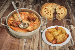 Plateful Of Cabbage Rolls With Smoked Pork Ribs And Pitta Bread On Old Rustic Garden Table Royalty Free Stock Photography