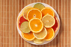 Plateful of citrus slices Royalty Free Stock Photos