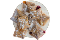 Plateful of crispy pastries with cheese and fruit Stock Photography