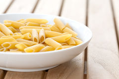 Plateful of dried penne past Stock Image