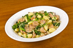 Gnocchi with Rapini and Italian Sausages #4. Plateful of gnocchi with Rapini, Italian sausages, Crimini mushrooms and onion #4 royalty free stock photography