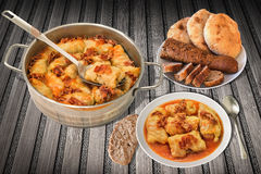 Plateful Of Pickled Cabbage Rolls Served On Rustic Bamboo Place Mat With Pitta Loafs And Sliced Integral Baguette Stock Photo