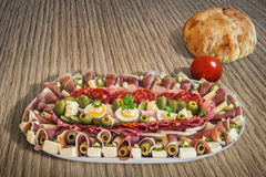 Plateful Of Traditional Serbian Appetizer Dish Meze With Pitta Bread And Tomato Set On Wooden Table Surfac Stock Image
