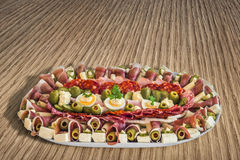 Plateful of Serbian Appetizer Meze on Wooden Table Royalty Free Stock Photo