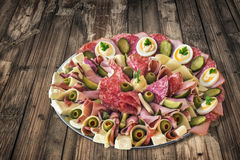 Plateful of Serbian Savoury Appetizer Meze on very old Wooden Ta Stock Photos