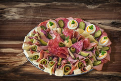 Plateful of Serbian Savoury Appetizer Meze on very old Wooden Ta Stock Image