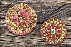 Plateful of Serbian Traditional Appetizer Savory Dishes Meze set on Old Wood Background Stock Images