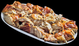 Plateful of Spit Roasted Pork Slices Isolated on Black Background Stock Photo