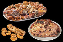 Plateful Of Spit Roasted Pork Slices And Juicy Pork Ham With Sesame Puff Pastry Croissant Isolated On Black Background. Plateful of delicious, gourmet, freshly Stock Photos