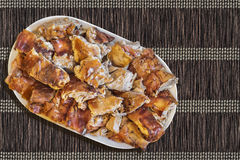 Plateful Of Spit Roasted Pork Slices Set On Interlaced Brown Paper Parchment Place Mat Grunge Surface Stock Photography